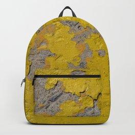 Yellow Peeling Paint on Concrete 1 Backpack