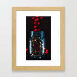 Blue mason jar with fairy lights and a red heart bokeh background Framed Art Print