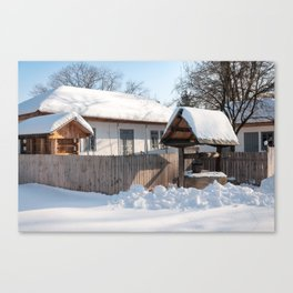 Sunny day at a beautiful heritage Romanian house covered in heavy snow Canvas Print