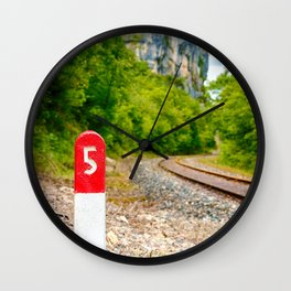 Railway pole sign close-up with number five along railroad track Wall Clock