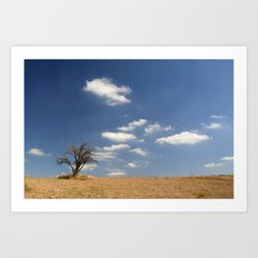 Clouds and tree... Art Print