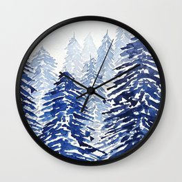 A snowy pine forest Wall Clock