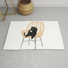 Lazy cat 2 enjoying coffee on rattan chair  Rug