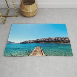 The bay of Baska in a sunny day Rug