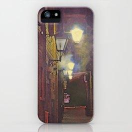 lamplit city alleyway iPhone Case