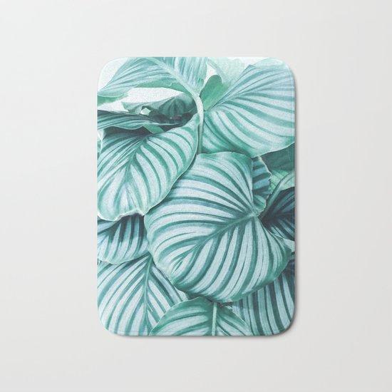 Long embrace - teal green Bath Mat