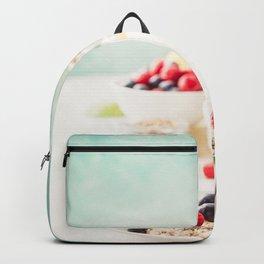 Oatmeal porridge with fresh berries, fruits and almond milk. Backpack