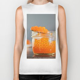 Macro shot of red caviar on jar on a gray background Biker Tank