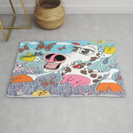 happy cow in a field of lavender with rabbits and butterflies Rug