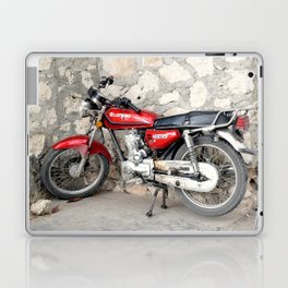 Motorbike red parked by the cement wall Laptop & iPad Skin