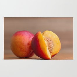Cut nectarine on wood close front view Rug