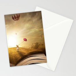 Girl with Balloons at Sunset atop open book magical realism portrait painting Stationery Cards