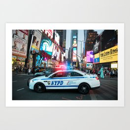 NYPD police squad car goes to emergency call with alarm and siren light in the Time Square streets o Art Print