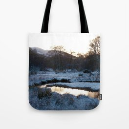 Snow on the hills Tote Bag