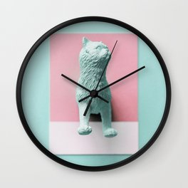 Half of cat figure on a pink paper Wall Clock