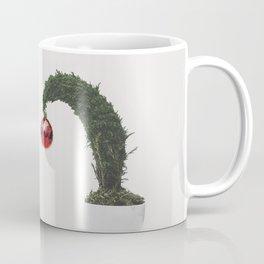 Christmas bauble on a tiny tree Coffee Mug