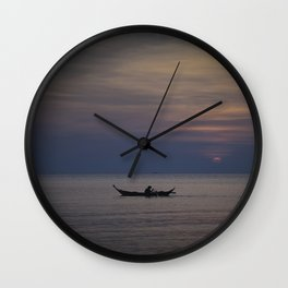Rowing into the sunset II Wall Clock