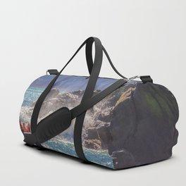 Small boat and waves crashing over rocks Duffle Bag