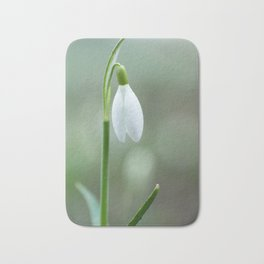 Snowdrop spring flowers close-up macro with selective focus Bath Mat