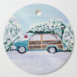 Blue vintage Christmas woody car with pine tree Cutting Board