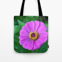 rileigh smirl Tote Bags featuring Bright Flower by Rileigh Smirl