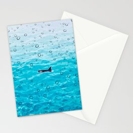 Orca Whale gliding through the water on a rainy day Stationery Cards