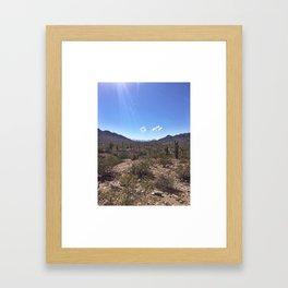 between two Framed Art Print