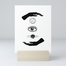 Two hands, between them the moon, eye and planet. Black and white. Mini Art Print