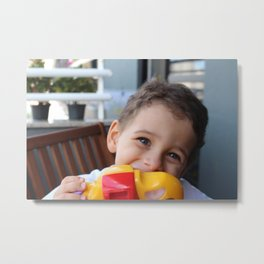 A boy smiling taking photos with a toy camera.  Metal Print