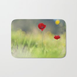 Two red poppies in a field of grass Bath Mat