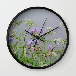 wet wild flowers by the lake Wall Clock