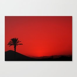 Red Andalusian sunset with silhouette palm tree and mountain Canvas Print