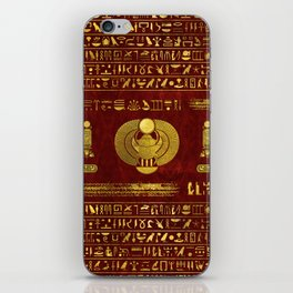 Golden Egyptian Scarab on red leather iPhone Skin