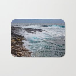 troubled waters rocky shore Bath Mat