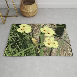 Pretty Yellow Flowers Nestled in Blades of Grass Rug