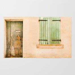 Green wooden door and shuttered window Rug