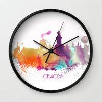 poland Wall Clocks featuring Cracow Poland skyline by jbjart