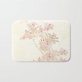Watercolour of pink blossom Bath Mat