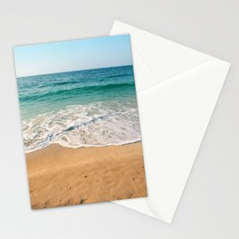 Sandy beach at noon with blue water and clear sky Stationery Cards