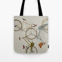 bicycles Tote Bags featuring bicycles by Golden Boy