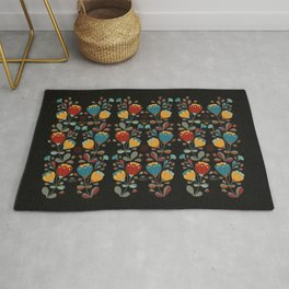 Vintage Ethno Flowers in red, blue, yellow on black Rug