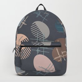 Comb and hand-mirror abstract with dark background Backpack