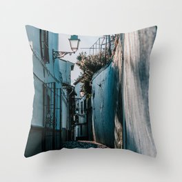 Small, narrow street with street light in Granada, Andalusia, Spain Throw Pillow