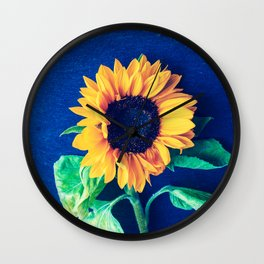 A decorative sunflower on the blue background Wall Clock