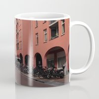 greg guillemin Mugs featuring Amsterdam - Greg Katz by Artlala for MSF Doctors Without Borders