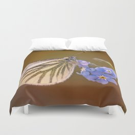 White and cream butterfly on forget-me-not flowers Duvet Cover