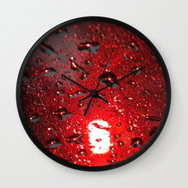 Abstract red lights of a rainy city Wall Clock