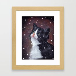 Tuxedo Cat Looking Up at Snowflakes Framed Art Print