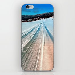 Winter road into the mountains iPhone Skin