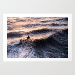 Lone surfer at sunset waiting for the next wave Art Print